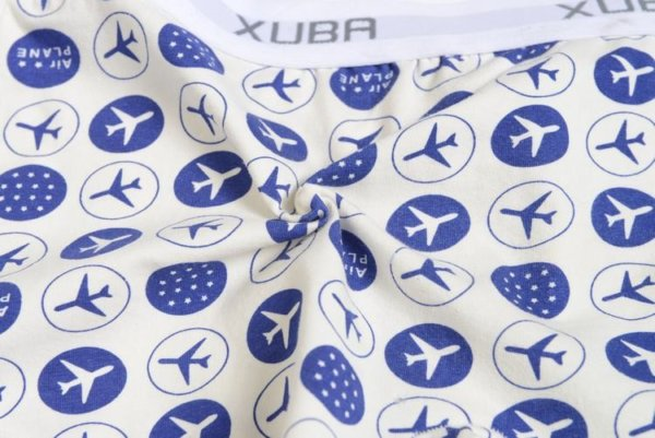 First Class white cotton boxer decorated with blue planes and stars and contains a grey belt