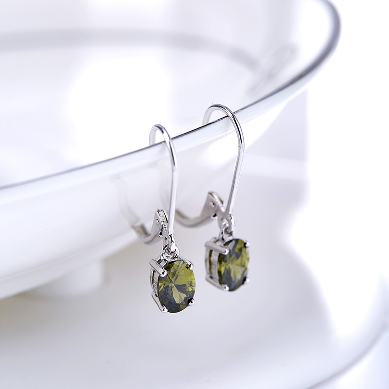 Silver 925 Earring decorated by olive green crystal bezel
