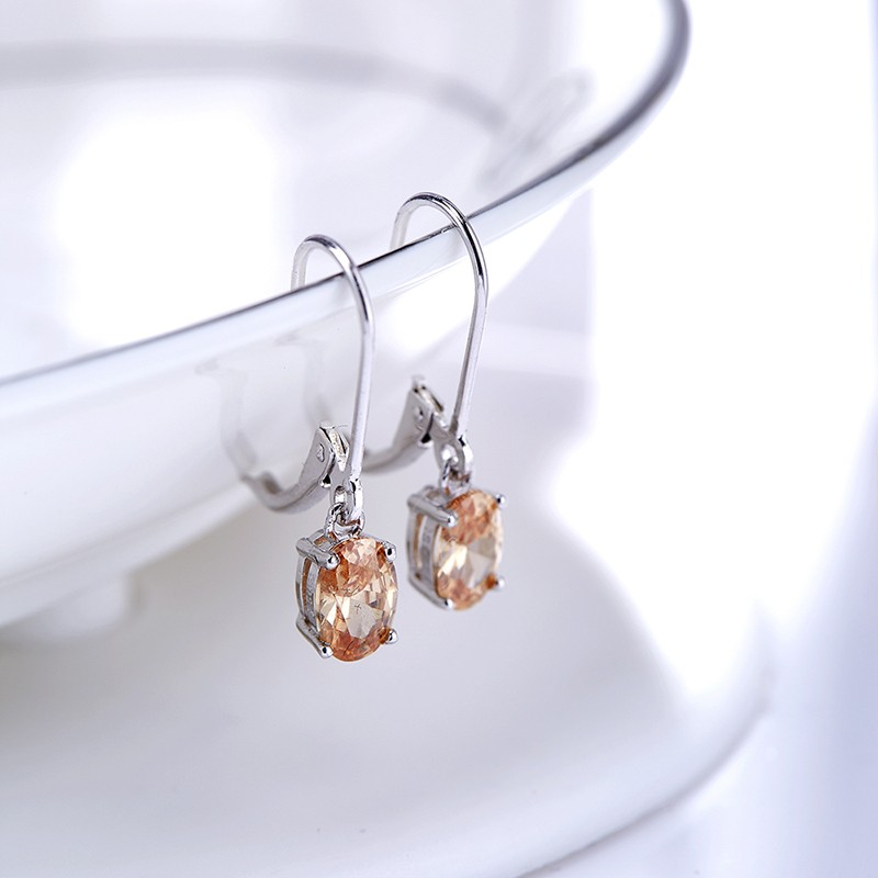 Silver 925 Earring decorated by champagne crystal bezel