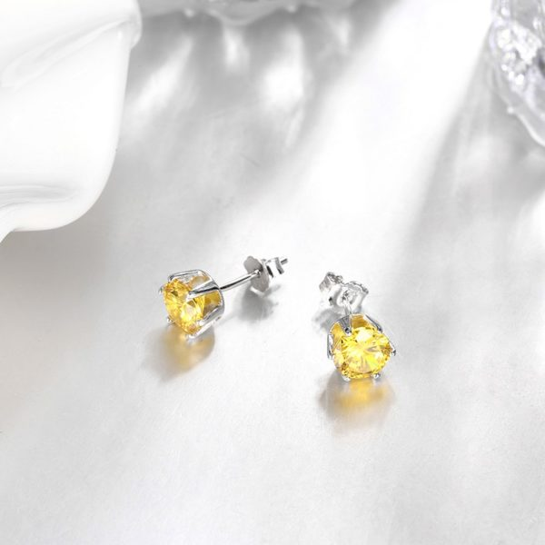 Silver 925 Earring decorated by yellow crystal bezel