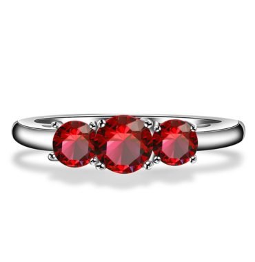 Luxurious silver 925 ring inlaid with three red zircon bezel and side white special crystals