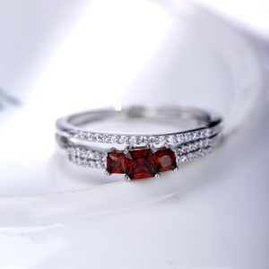 Luxurious silver 925 twins rings inlaid with three red zircons and side white special crystals