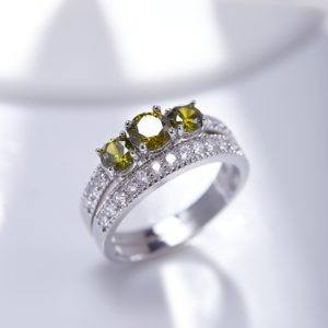 Luxurious silver 925 twins rings inlaid with three olive green zircons and side white special crystals