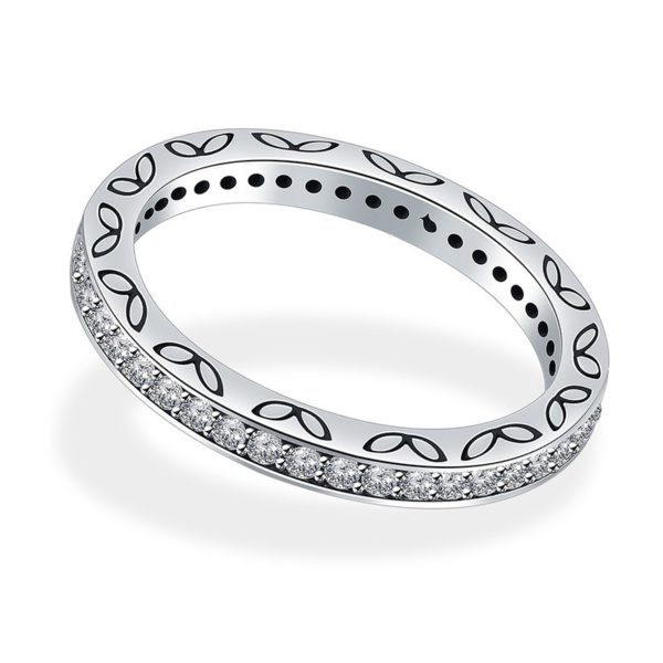 Silver 925 ring inlaid with white crystals on the edges and simple butterflies and dots decorate the ring