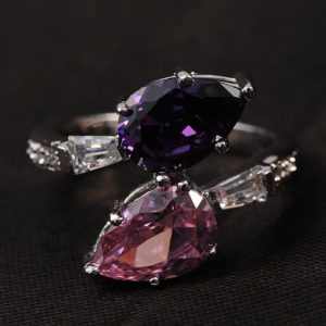 Special copper ring inlaid with white crystals and two big Violet and pink zircons