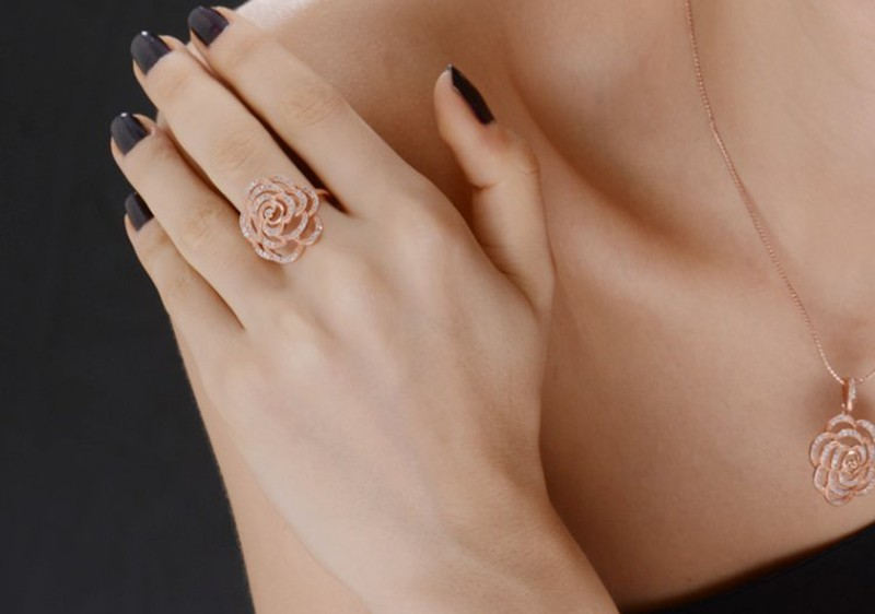 Copper ring plated with three layers of gold and inlaid with white zircons