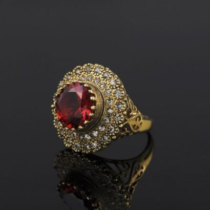 Copper ring three times of gold plating with a classical design and inlaid with red zircon