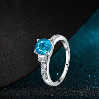 Special white copper ring inlaid with special white crystal and sky blue zircon