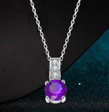Necklace with unique design inlaid with a violet zircon