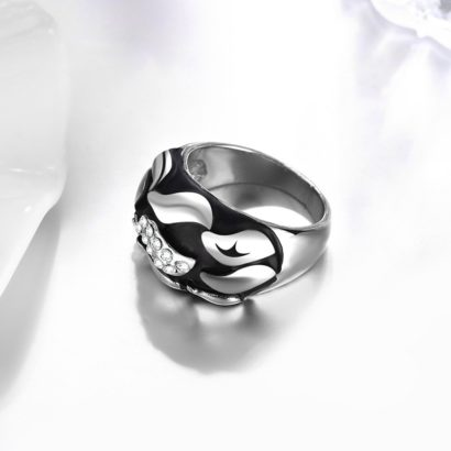 Water drop ring is a unique design plated with platinum and inlaid with diamond crystals and decorated by black oil drip