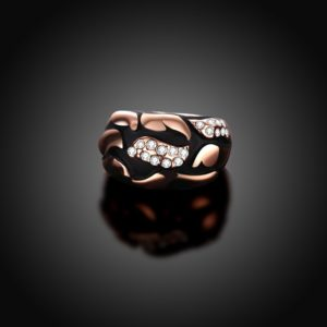 Water drop is a unique ring plated with rose gold and inlaid with diamond crystals and decorated by black oil drip