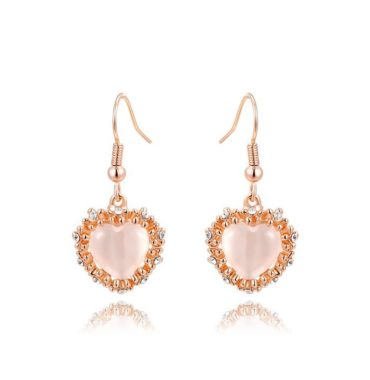 The pink Heart earring, three times gold plated and inlaid with pink opal surrounded by special crystals