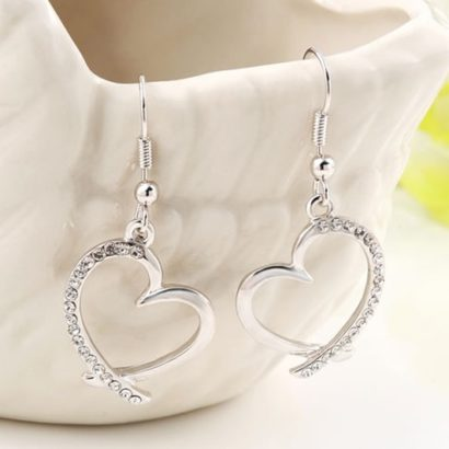 The Heart earring, three times gold plated and inlaid with special white crystals