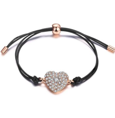 Leather bangle inlaid with special rose gold pieces and a heart of diamond