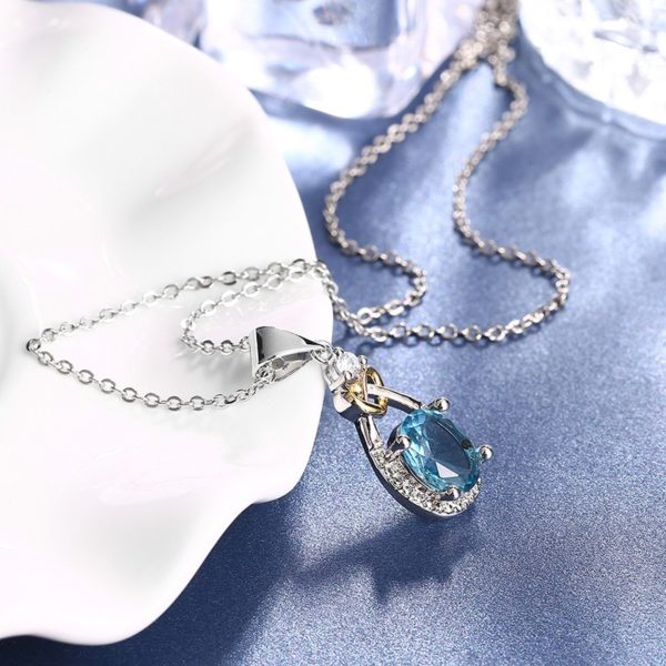Heart and water drop necklace, plated with silver and inlaid with blue crystal