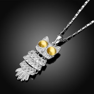 The owl necklace plated with platinum and the eyes are inlaid with brown opals.