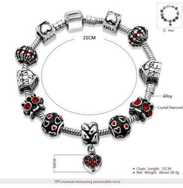 Silver bangle inlaid with special ornaments and red crystal diamonds and a unique design of heart