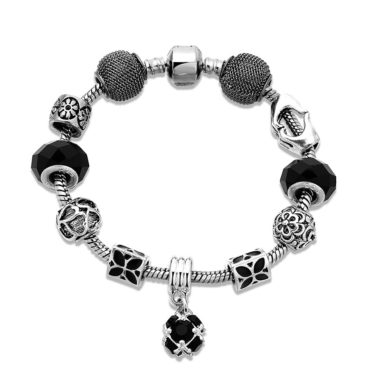 Silver bangle inlaid with special ornaments and a black crystal diamond