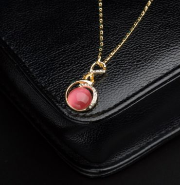 Unique design gold plated necklace inlaid with white crystals and pink opal