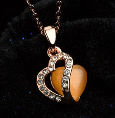Heart necklace, plated with gold and inlaid with white crystals and an orange opal